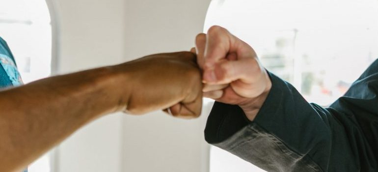 two people fistbumping